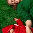 Young girl and her child on green grass - Stock Photo