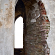 Window opening in brick ancient wall — Stock Photo #1043358