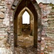 Royalty-Free Stock Photo: Ancient arches through the brick walls w