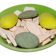 Green plate with color pebbles - Stock Photo
