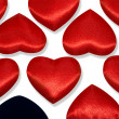 Red hearts and one black heart — 图库照片