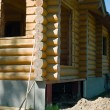 Wooden coner of house under construction - Stock Photo