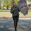 Stock Photo: Young Woman Stays With Grey Umbrella