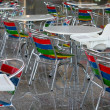 Color seats and white tables on the shin — Stock Photo