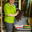 Woman in the wardrobe packs things into — Stock Photo #1043950