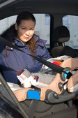 Mother and child in safety seat — Stock Photo