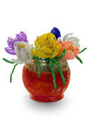 Red vase with flowers from glass beads a — Stock Photo