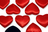 Red hearts and one black heart — Stock Photo