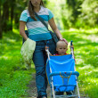 Stock Photo: Mother and her son on footpath in park