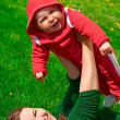 Woman and her child on the green grass — Stock Photo