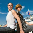 Man and woman siting near cruise liners — Stock Photo