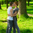 Stock Photo: Kissing couple in park