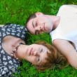 Loving couple on green meadow — Stock Photo