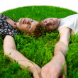 Royalty-Free Stock Photo: Teens on grass (fisheye)