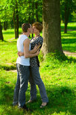Kissing couple in park — Stock Photo