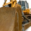 Royalty-Free Stock Photo: Yellow pushdozer with bulldozer blade