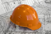 Orange constructional helmet and project — Stock Photo