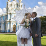Loving newlywed about church — Stock Photo