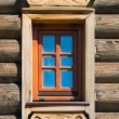 Ancient wooden window in timber wall — Stock Photo #1584483