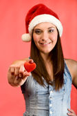 Young beautiful woman with red heart — Stock Photo