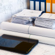 Laptop near pile of project drawings — Stock Photo
