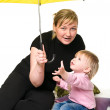Mother and little child under umbrella — Stock Photo #2431328