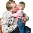 Stock Photo: Father kissing a child