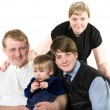 Happy young parents and children — Stock Photo