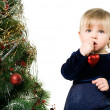 Little girl near the Christmas tree — Stok fotoğraf