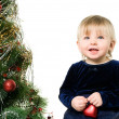 Little girl near the Christmas tree - Stock Photo