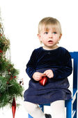 Little girl near the Christmas tree — Stock Photo