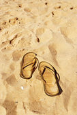Slippers on the beach — Stock Photo