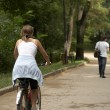 Young woman riding in the park - Stock Photo