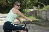 Young woman riding the bike — Stock Photo