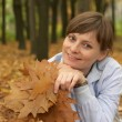 Woman holding leaves — Stock Photo