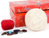 Box, wool and yarns — Stock Photo