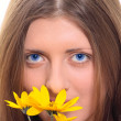 Royalty-Free Stock Photo: The nice girl with a yellow flower