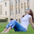 The nice girl having a rest on a grass — Stock Photo #1051291