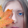 Portrait of the nice girl with a maple l — Stock Photo