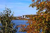 Kind on autumn village located lake — Stock Photo
