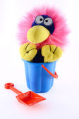 Toy sitting in a bucket — Stockfoto