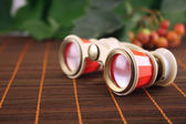 Opera glasses on a bamboo napkin — Stock Photo