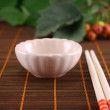 Royalty-Free Stock Photo: Cup and chopsticks