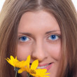 The cute girl with a yellow wild flower — Stock Photo #1193320