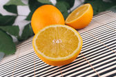 The cut orange on a bamboo napkin — Stock Photo