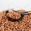 Russian wooden spoon buckwheat groats - Stock Photo