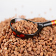 Russiwooden spoon buckwheat groats — Stock Photo #2144801