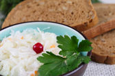 Salad and black bread — Stock Photo