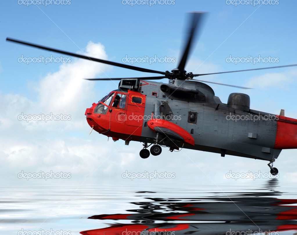 Rescue helicopter hovering just above the sea — Stock Photo #1292912