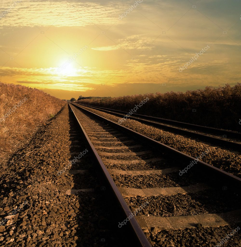 Rail track going into infinity with the sun setting  Stock Photo #1292960